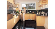 The Dimplex BFH range of plinth heaters fit neatly in the space beneath the kitchen cupboards