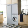 THE MAYTAG DRYING CABINET KEEPS LAUNDERED AND DAMP OUTDOOR CLOTHES IN ONE NEAT PLACE